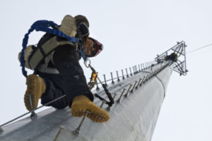 Tower climber ascending 100 feet cell tower